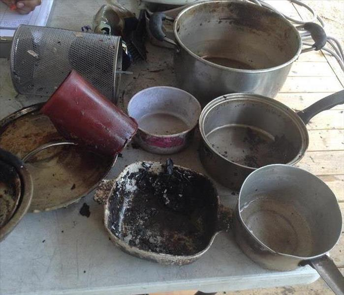 Pots and Pans that were scorched by a fire in Gonzales, Texas.